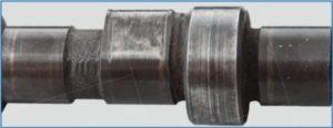 Nadměrné opotřebení palce vačky váčkového hřídele